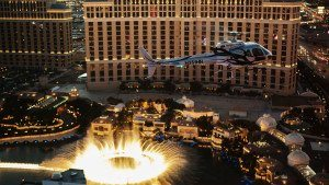Helicopter flying over Bellagio fountains